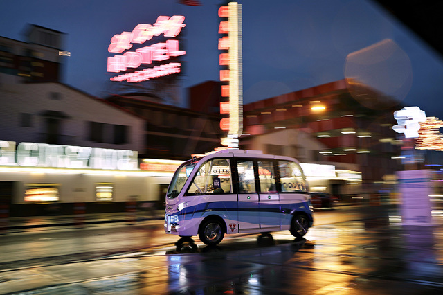 In this Jan. 12, 2017, photo, the Navya Arma autonomous vehicle drives down a street in Las Vegas. The driverless electric shuttle has begun carrying passengers in a test program in a downtown Las ...