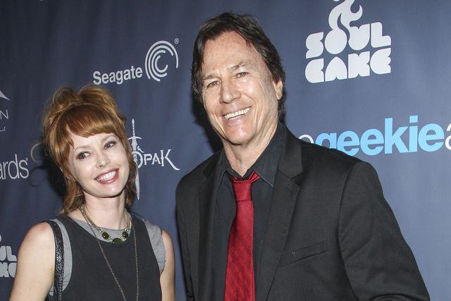 In this Aug. 18, 2013 file photo, actor Richard Hatch, right, and guest arrive at the 2013 Geekie Awards at the Avalon in Los Angeles. Hatch, perhaps best known for playing Captain Apollo in the o ...