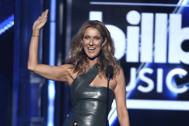 Celine Dion presents the award for top male artist at the Billboard Music Awards at MGM Grand Garden Arena on Sunday, May 17, 2015, in Las Vegas. (Chris Pizzello/Invision/AP)