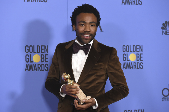 "Donald Glover poses in the press room with the award for best performance by an actor in a television series - musical or comedy for ""Atlanta"" at the 74th annual Golden Globe Awa ..."