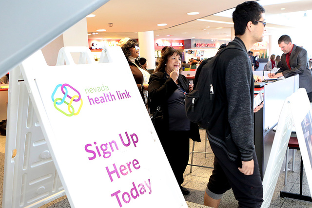 A student leaves Health Link sign up booth during campus events for students to enroll in health insurance coverage and learn about the future of the Affordable Care Act at UNLV Student Union on T ...