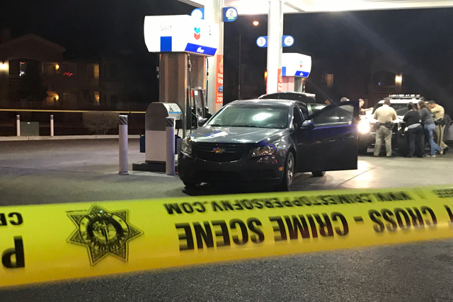 Police investigate a shooting at a Chevron gas station at 7730 S. Jones Blvd. on February 10, 2017. (Rio Lacanlale/Las Vegas Review-Journal)