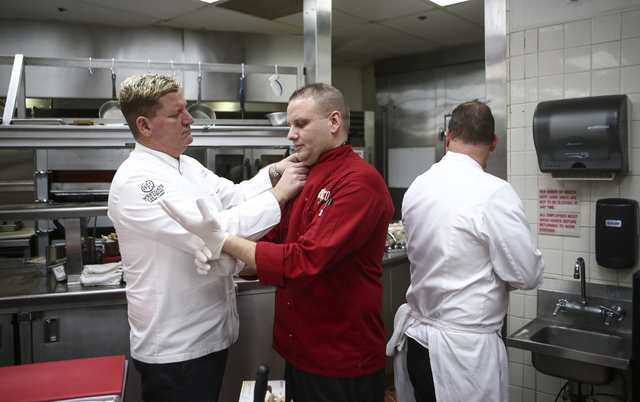 Westgate Executive Director of Culinary Charles Wilson, left, assists Fresco Chef de Cuisine Michael McNeilly before preparing a dish at Edge Steakhouse at the Westgate hotel-casino in Las Vegas o ...