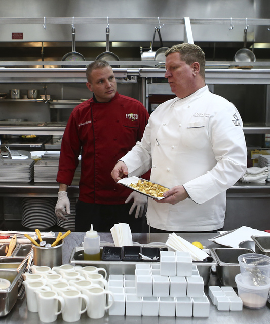 Fresco Chef de Cuisine Michael McNeilly, left, talks with Westgate Executive Director of Culinary Charles Wilson before preparing a dish at Edge Steakhouse at the Westgate hotel-casino in Las Vega ...