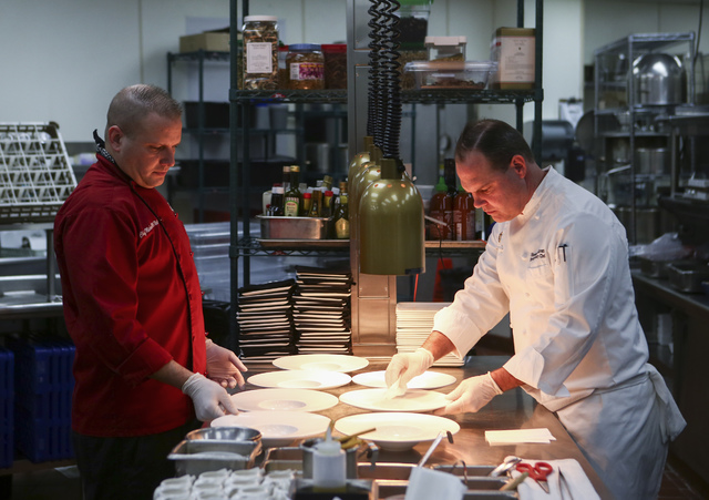 Fresco Chef de Cuisine Michael McNeilly, left, prepares dishes with Westgate Executive Pastry Chef Stephen Sullivan at Edge Steakhouse at the Westgate hotel-casino in Las Vegas on Friday, Jan. 27, ...