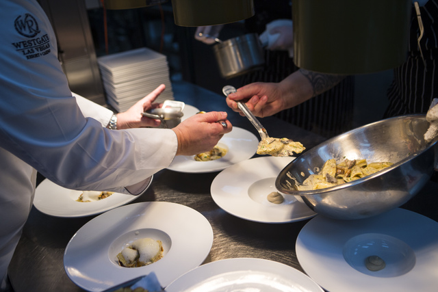 Westgate chefs prepare sunchoke agnolotti at Edge Steakhouse at the Westgate hotel-casino in Las Vegas on Friday, Jan. 27, 2017. Four chefs from the hotel-casino are slated to prepare a dinner at  ...