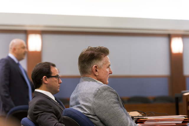 Brent Dennis, the psychologist facing a murder charge in the death of his wife, attorney Susan Winters, listens at his hearing at the Regional Justice Center on Tuesday, Feb. 21, 2017.  (Elizabeth ...