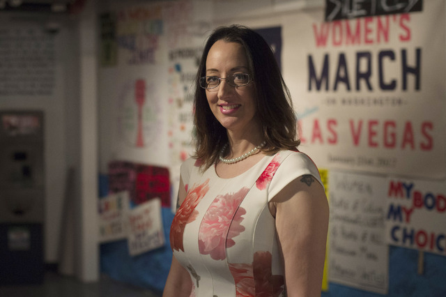 Executive Director Dr. Victoria Hartmann in front of posters from the Las Vegas Women's March that are set on display at the Erotic Heritage Museum in Las Vegas on Thursday, Feb. 2, 2017. Hartmann ...