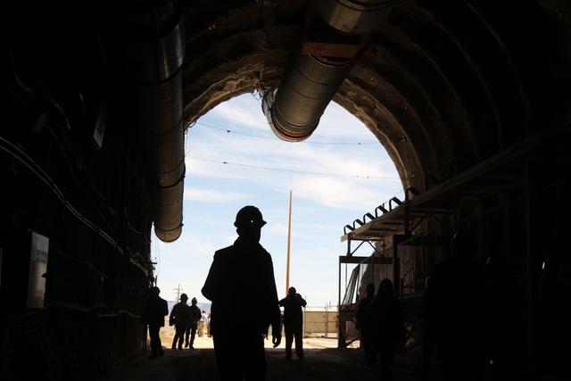 Congressmen's staff, journalists and Department of Energy employees explore the north portal during a congressional tour of the Yucca Mountain exploratory tunnel Thursday, April 9, 2015. (Sam Morr ...