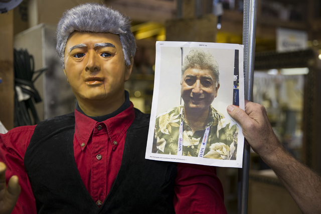 Olaf Stanton, owner of Characters Unlimited, shows a picture of client next to the character ordered to resemble him at his company's workshop on Thursday, Feb. 2, 2017, in Boulder City. (Erik Ver ...