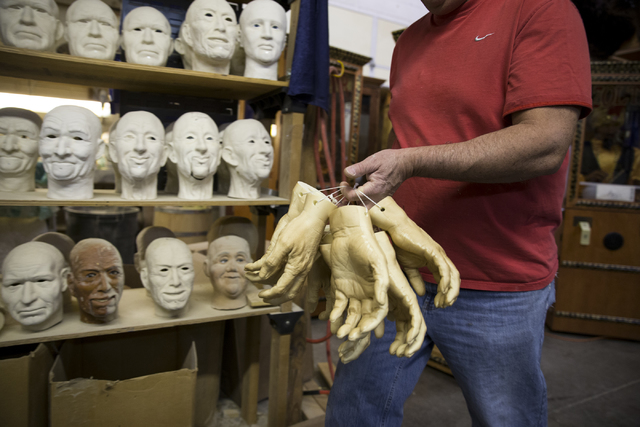 Tom Canterbury moves character hands to the paint room at the Characters Unlimited workshop on Thursday, Feb. 2, 2017, in Boulder City. (Erik Verduzco/Las Vegas Review-Journal) @Erik_Verduzco