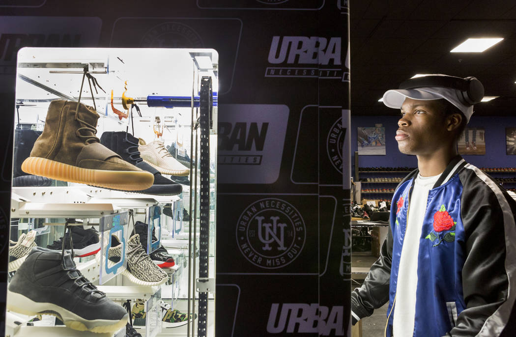 official photos e9dd8 5138b Christian Williams, a customer of Urban Necessities, a premier sneaker  consignment boutique, plays