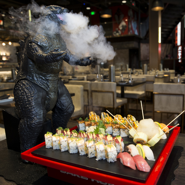 The Godzilla Platter, served with five different sushi rolls that include the tempura roll, tiger roll, girl on the beach roll, el chapo roll, and rok & roll, and four type of nigiri that incl ...