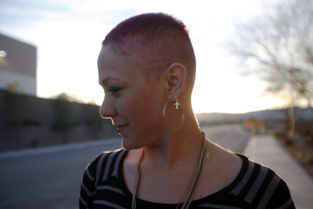 Stacy Cerame shows her short hair in front of the American Cancer Society on Monday, Feb.13, 2017, in Las Vegas. Cerame was diagnosed with breast cancer in October, had surgery to remove it, then  ...