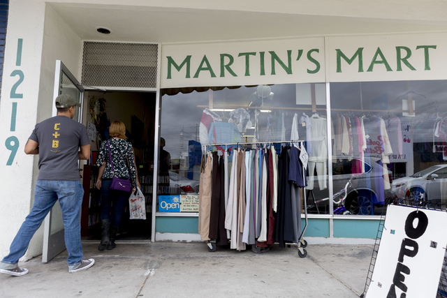 a86832ef2e Customers enter Martin s Mart Thrift shop located at 1219 South Main  Street