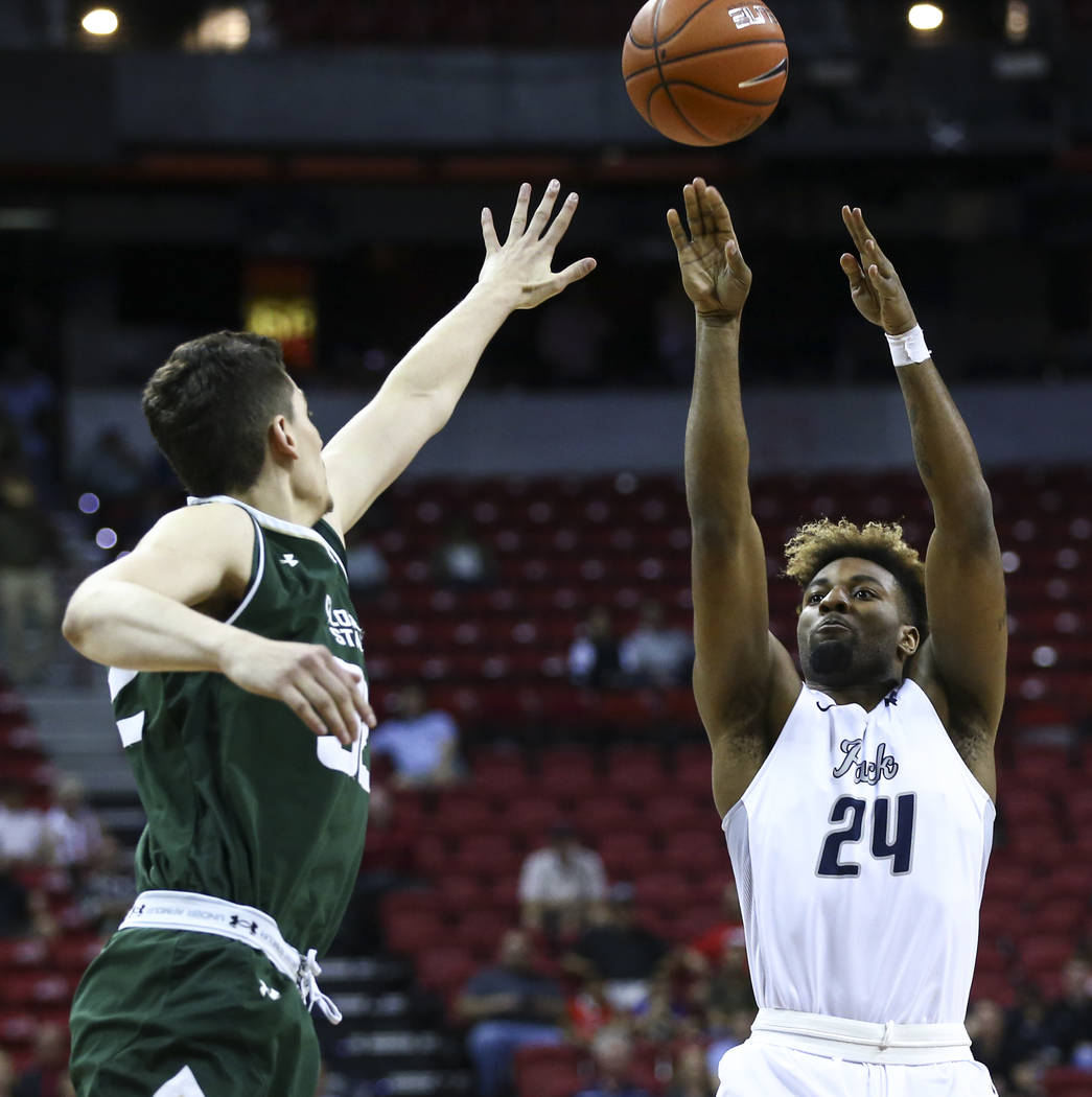 UNR guard Jordan Caroline (24) shoots over Colorado State forward Nico Carvacho (32) during the Mountain West Conference basketball championship game at the Thomas & Mack Center in Las Vegas o ...