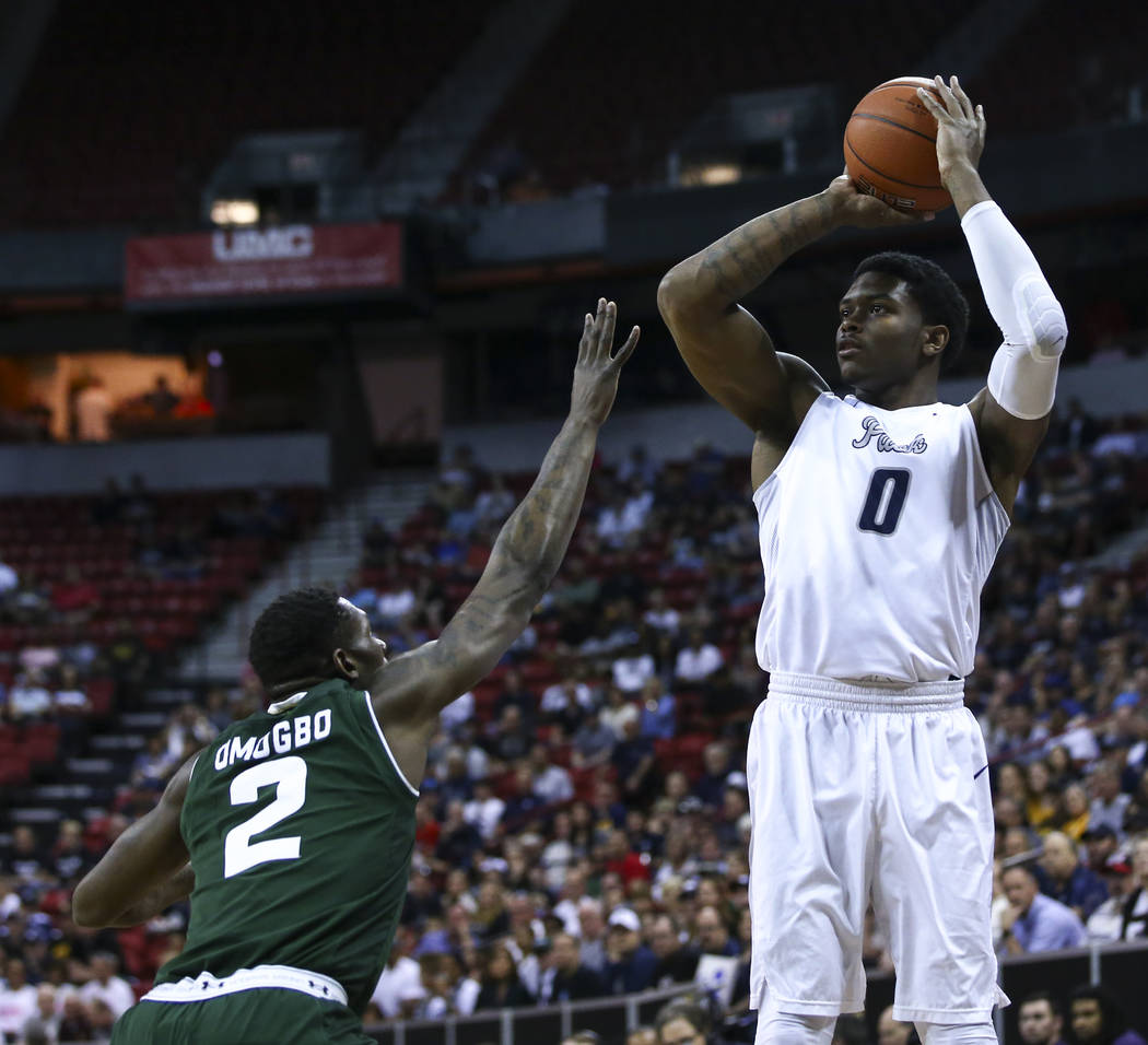 UNR forward Cameron Oliver (0) shoots over Colorado State forward Emmanuel Omogbo (2) during the Mountain West Conference basketball championship game at the Thomas & Mack Center in Las Vegas  ...