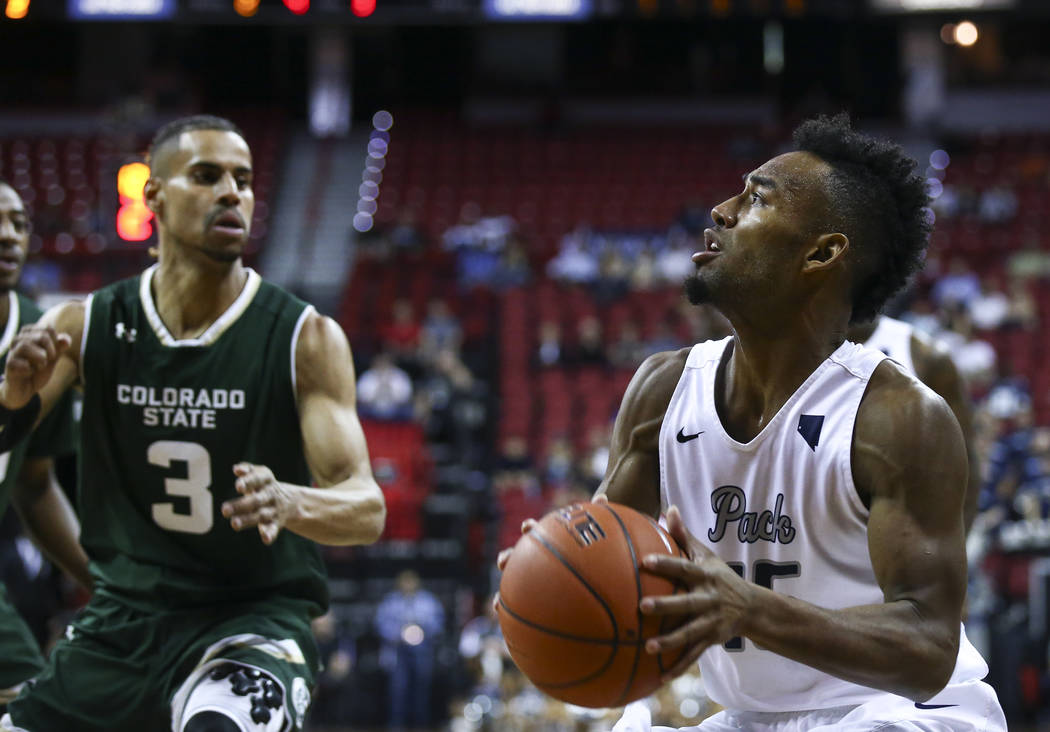 UNR guard D.J. Fenner (15) drives to the basket against Colorado State guard Gian Clavell (3) during the Mountain West Conference basketball championship game at the Thomas & Mack Center in La ...