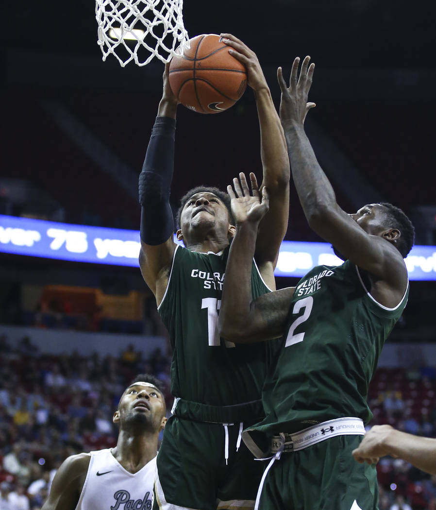 Colorado State guard Prentiss Nixon (11) pulls in a rebound next to Colorado State forward Emmanuel Omogbo (2) during the Mountain West Conference basketball championship game at the Thomas &  ...