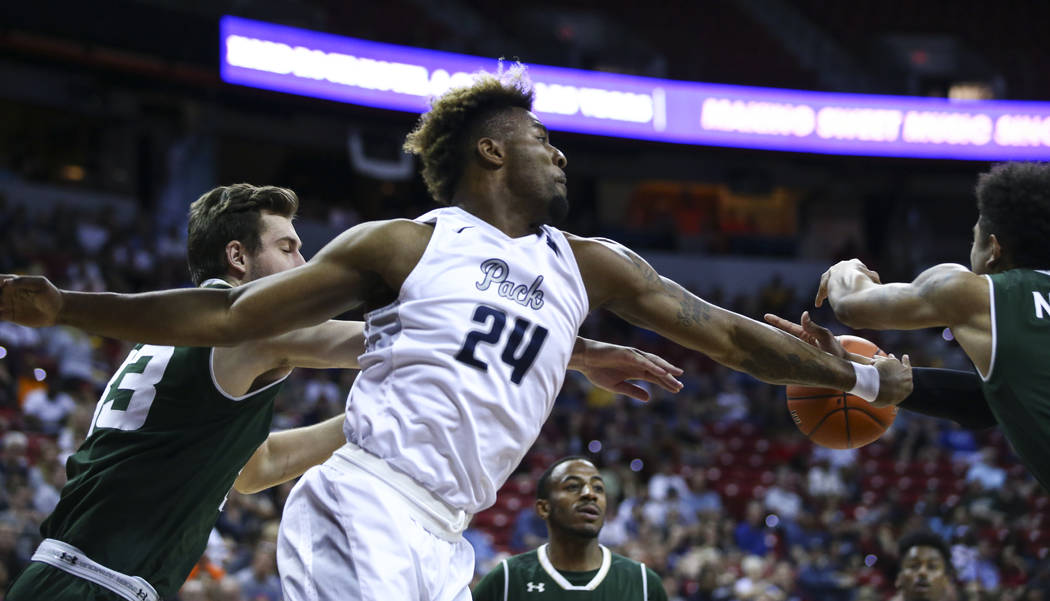 UNR guard Jordan Caroline (24) tries to get a rebound against Colorado State during the Mountain West Conference basketball championship game at the Thomas & Mack Center in Las Vegas on Saturd ...