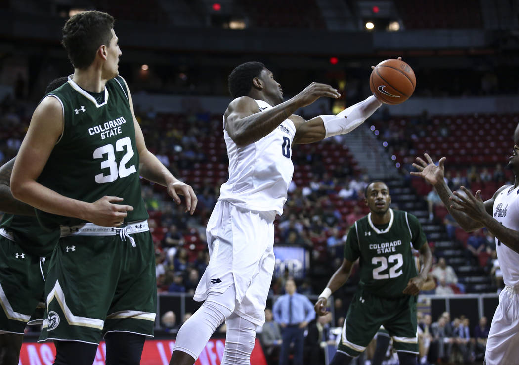 UNR forward Cameron Oliver (0) pulls in a rebound over Colorado State during the Mountain West Conference basketball championship game at the Thomas & Mack Center in Las Vegas on Saturday, Mar ...