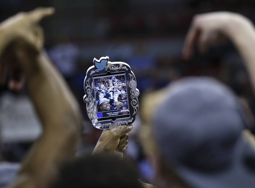 UNR players celebrate with a selfie after defeating Colorado State 79-71 in the Mountain West Conference basketball championship game at the Thomas & Mack Center in Las Vegas on Saturday, Marc ...