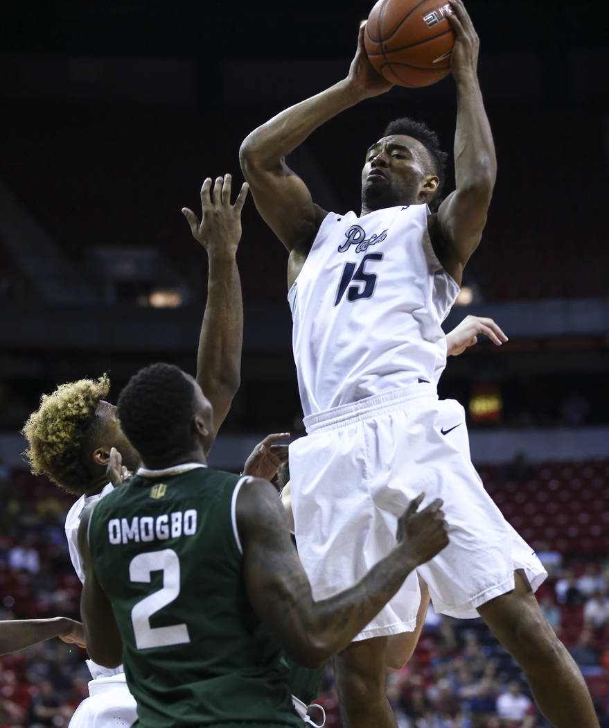 UNR guard D.J. Fenner (15) takes in a rebound over Colorado State forward Emmanuel Omogbo (2) during the Mountain West Conference basketball championship game at the Thomas & Mack Center in La ...