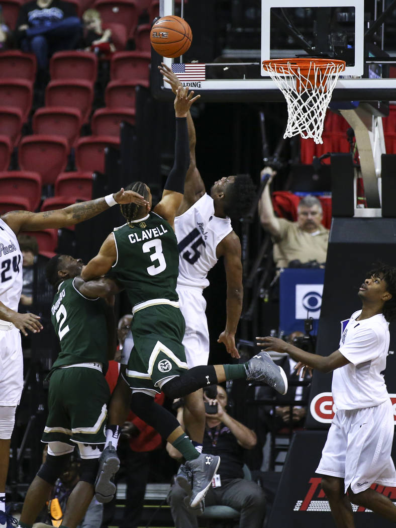 UNR guard D.J. Fenner (15) blocks a shot from Colorado State guard Gian Clavell (3) during the Mountain West Conference basketball championship game at the Thomas & Mack Center in Las Vegas on ...