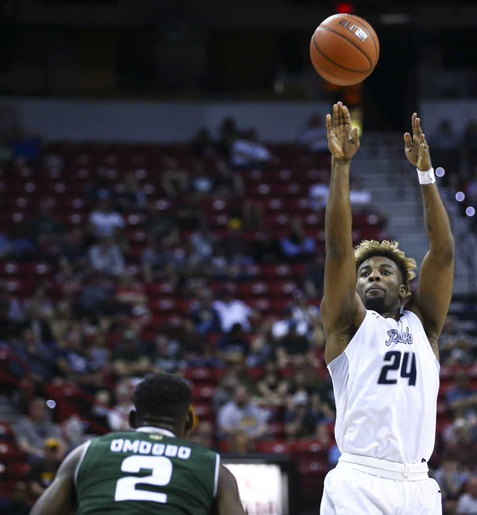 UNR guard Jordan Caroline (24) shoots over Colorado State forward Emmanuel Omogbo (2) during the Mountain West Conference basketball championship game at the Thomas & Mack Center in Las Vegas  ...