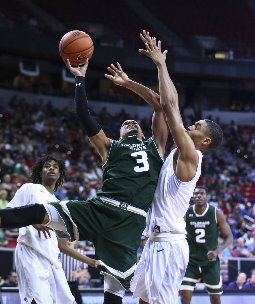 Colorado State guard Gian Clavell (3) shoots against UNR guard Josh Hall (33) during the Mountain West Conference basketball championship game at the Thomas & Mack Center in Las Vegas on Satur ...