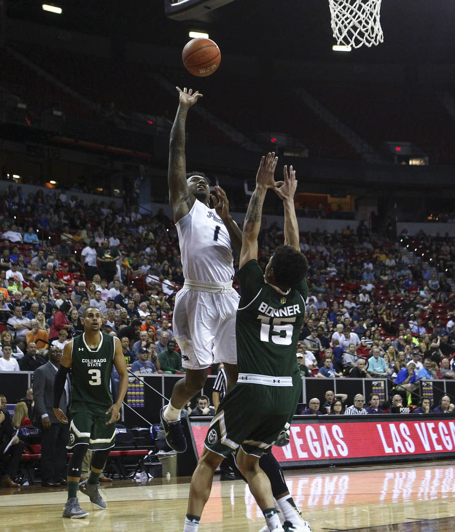 UNR guard Marcus Marshall (1) shoots over Colorado State guard Anthony Bonner (15) during the Mountain West Conference basketball championship game at the Thomas & Mack Center in Las Vegas on  ...