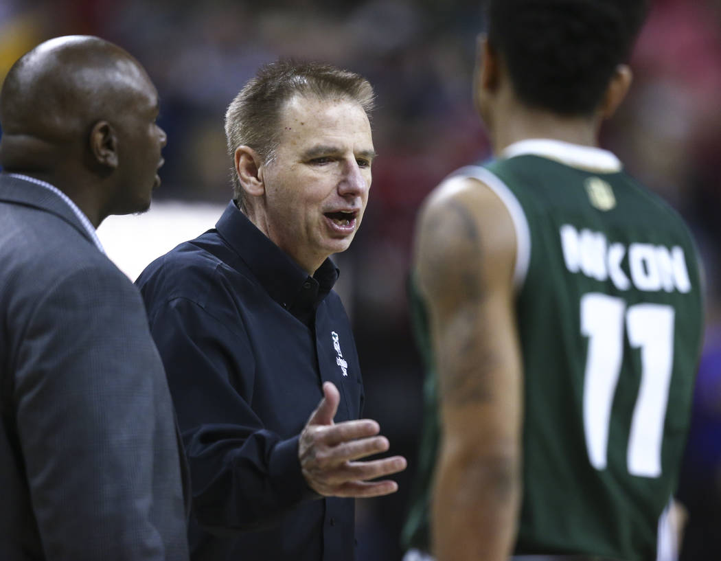 Colorado State head coach Larry Eustachy talks with Colorado State guard Prentiss Nixon (11) during the Mountain West Conference basketball championship game at the Thomas & Mack Center in Las ...