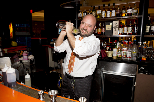 Hayes Swope, SUSHISAMBA Las Vegas' regional director of operations and a certified sake sommelier, mixes a Japanese whiskey cocktail at the restaurant located in the Grand Canal Shoppes at The Pal ...