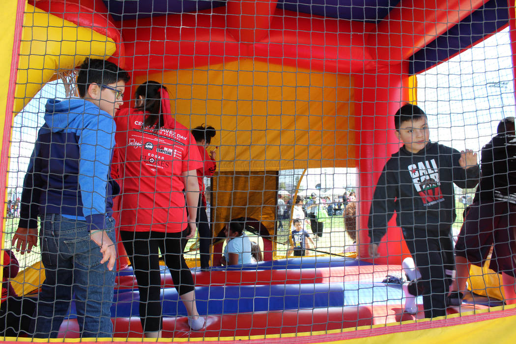 Kids and volunteers from the Cesar Chavez Foundation play in a bounce house at Gary Reese Freedom Park in Las Vegas during Cesar Chavez Day, Saturday, March 25, 2017. (Gabriella Benavidez/Las Vega ...