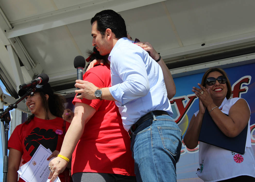 Rep. Ruben Kihuen, D-Nev., honors Valley High School teacher Tillie Torres for being an influential member of the Latino community in Las Vegas at Gary Reese Freedom Park during Cesar Chavez Day,  ...