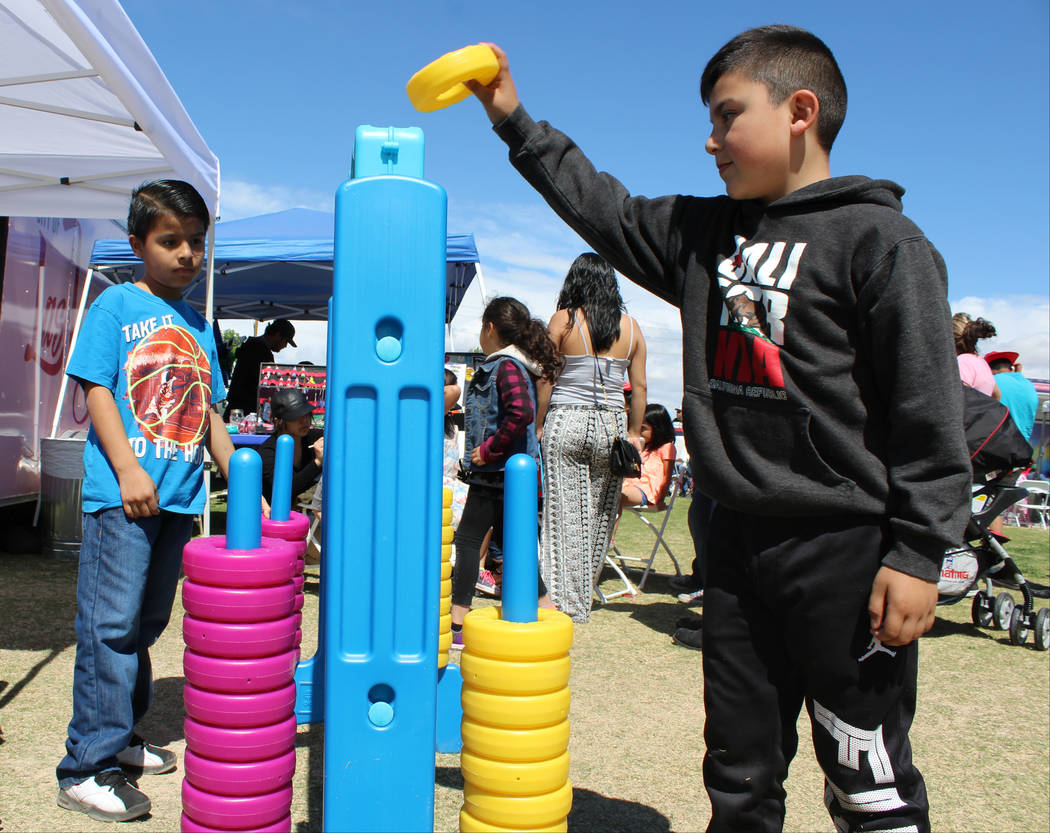 From left, Aden Perez, 9, and Anthony Delgado, 7, play a life-size game of tic-tac-toe at Gary Reese Freedom Park during Cesar Chavez Day, Saturday, March 25, 2017. (Gabriella Benavidez/Las Vegas  ...