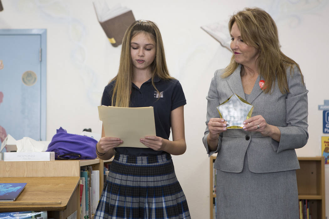 Peyton Barsel, left, and Adam's Place board president Kelly Thomas Boyd, right, present the Adam's Place Children's Voice award at Joseph Neal Elementary School on Tuesday, Feb. 28, 2017, in Las V ...