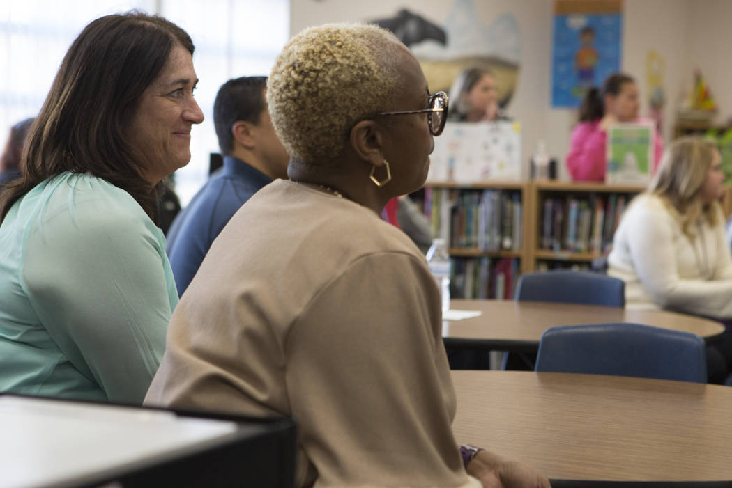 Counselor LeahAnn Siemen, far left, listen as the Adam's Place board president Kelly Thomas speaks about the the history of Adam's Place at Joseph Neal Elementary School on Tuesday, Feb. 28, 2017, ...