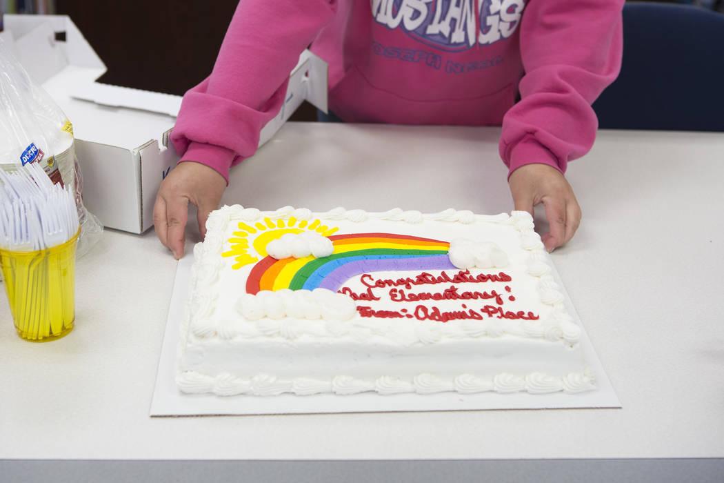 A staff member adjusts a cake that congratulates the school at Joseph Neal Elementary School on Tuesday, Feb. 28, 2017, in Las Vegas .  (Bridget Bennett/Las Vegas Review-Journal) @bridgetkbennett