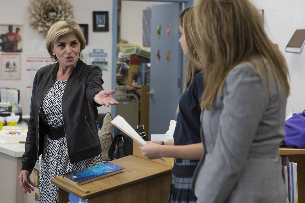 Principal Denise Murray, far left, introduces Peyton Barsel, center, and Adam's Place board president Kelly Thomas, right, at Joseph Neal Elementary School on Tuesday, Feb. 28, 2017, in Las Vegas. ...
