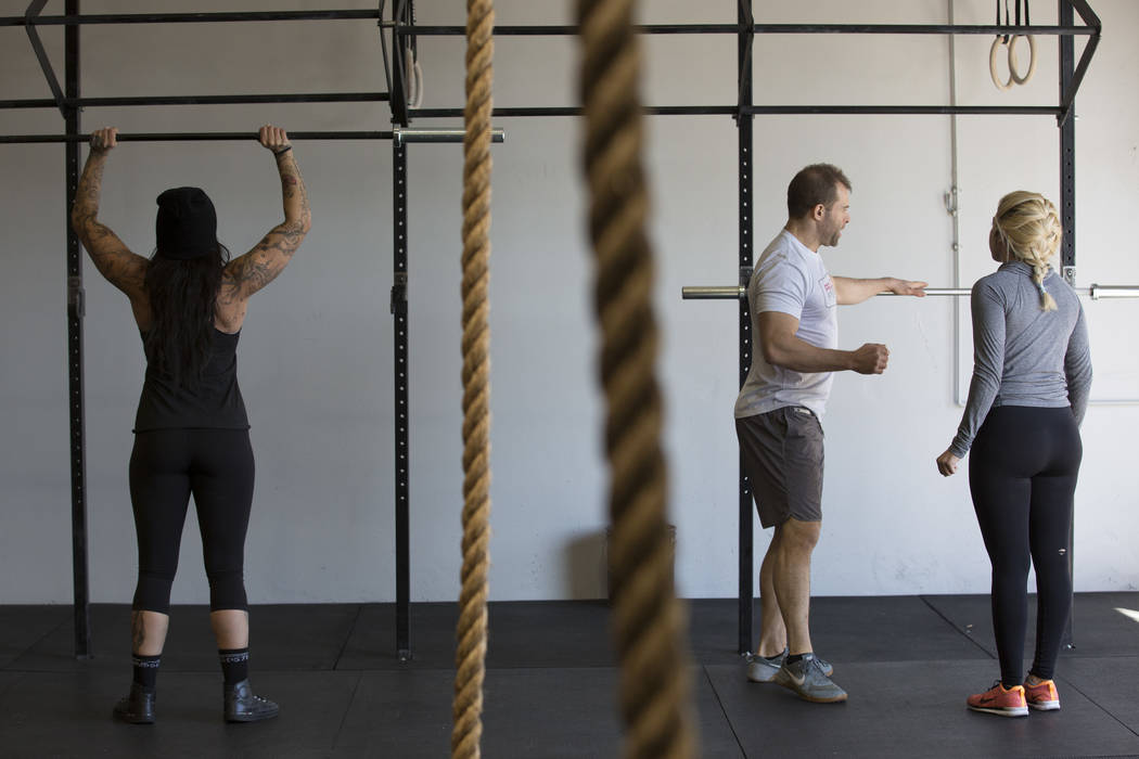 Drew Pollner guides Ambar Vizcarra, far right, during a training session at Project Fitness on Wednesday, March 1, 2017, in Las Vegas. Pollner recently opened Project Fitness which includes streng ...