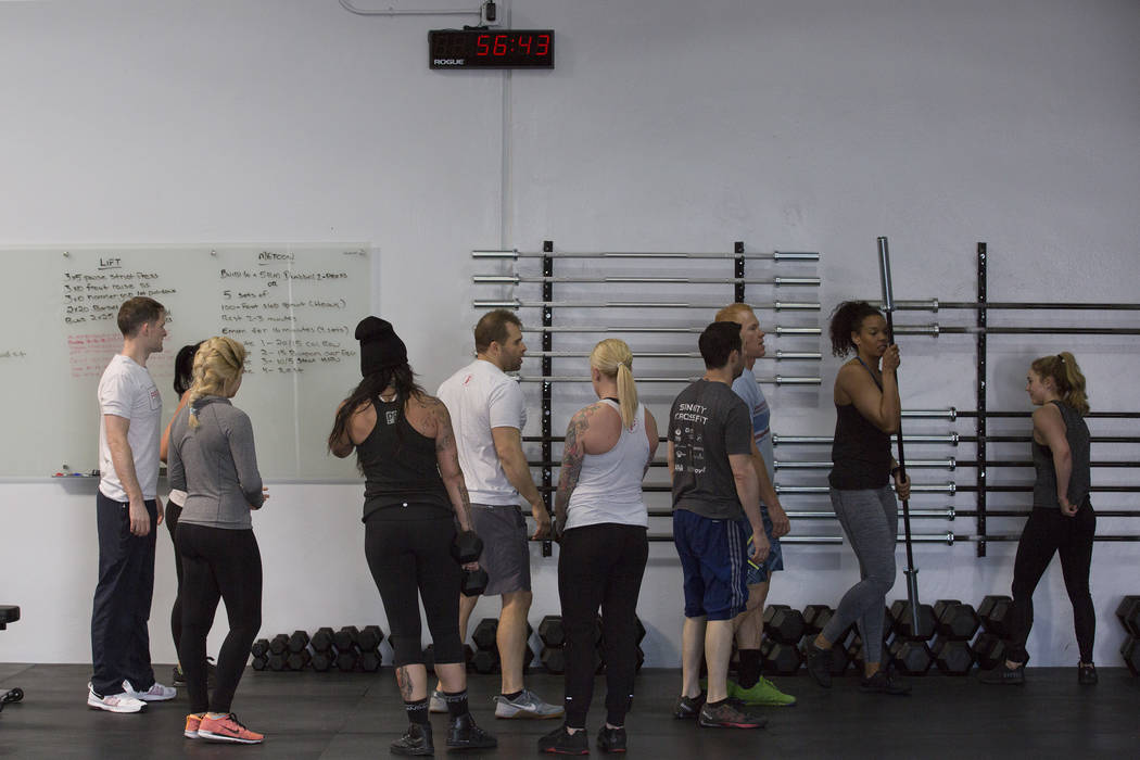 Attendees prepare for an exercise during a training session at Project Fitness on Wednesday, March 1, 2017, in Las Vegas. Pollner recently opened Project Fitness which includes strength training,  ...