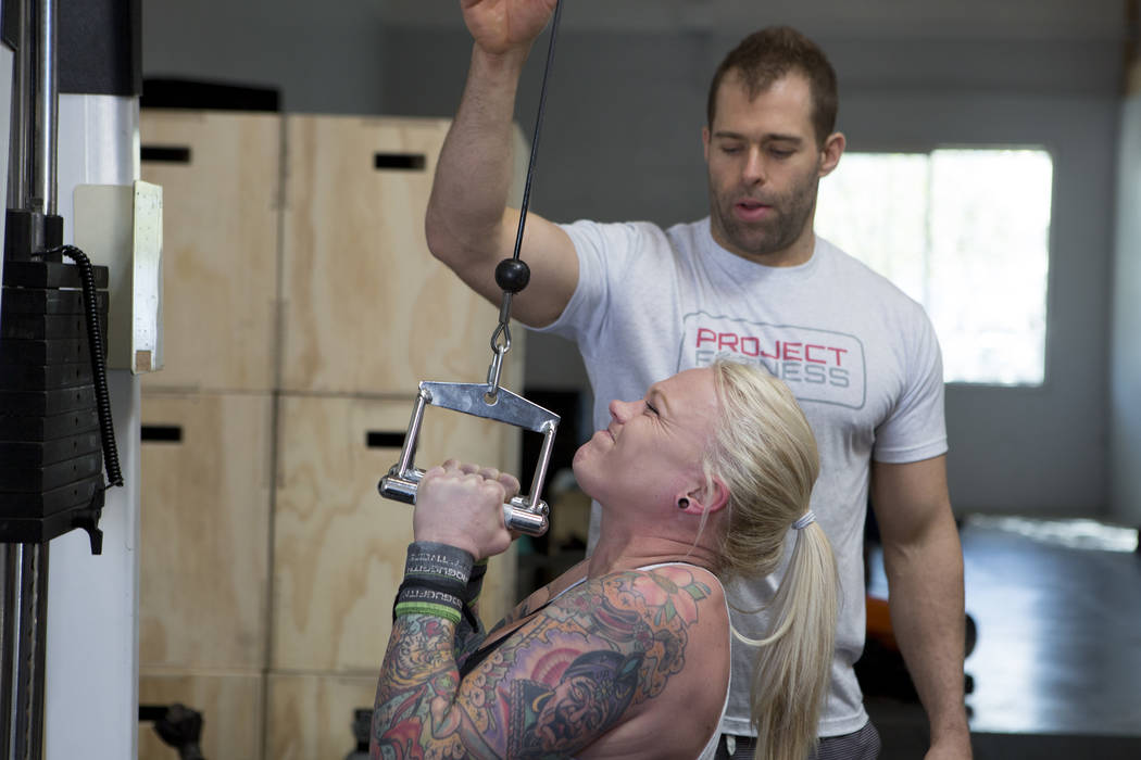Drew Pollner assists Ashley Spears during a training session at Project Fitness on Wednesday, March 1, 2017, in Las Vegas. Pollner recently opened Project Fitness which includes strength training, ...