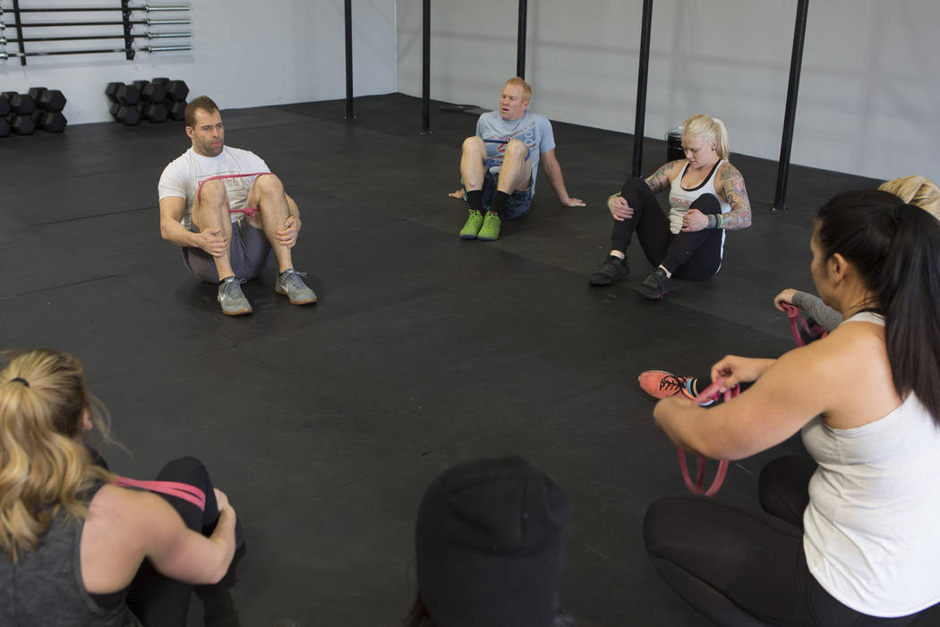 Drew Pollner  leads an exercise during a training session at Project Fitness on Wednesday, March 1, 2017, in Las Vegas. Pollner recently opened Project Fitness which includes strength training, Cr ...