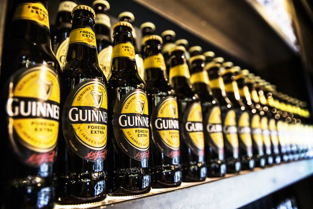Bottles of Guinness line the walls at The Guinness Experience on Thursday, March 2, 2017,at the Guinness Store in the Mandalay Bay hotel-casino, in Las Vegas.  (Benjamin Hager/Las Vegas Review-Jou ...