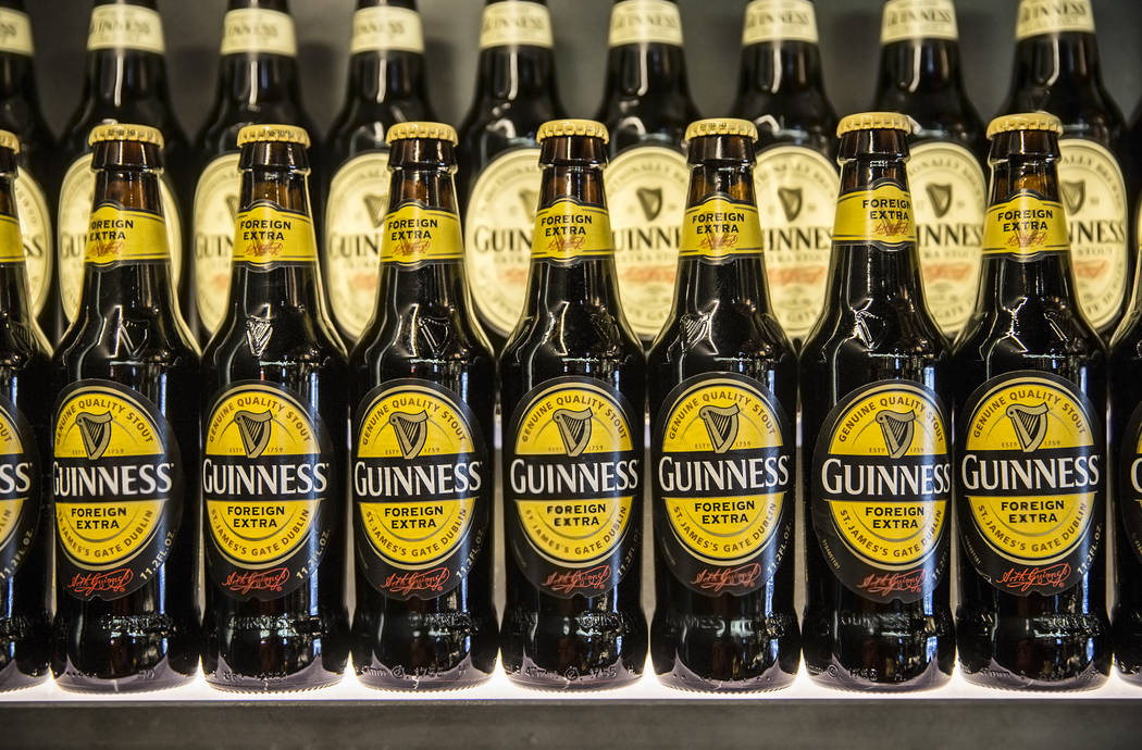 Bottles of Guinness line the walls at The Guinness Experience on Thursday, March 2, 2017, at the Guinness Store in the Mandalay Bay hotel-casino, in Las Vegas.  (Benjamin Hager/Las Vegas Review-Jo ...