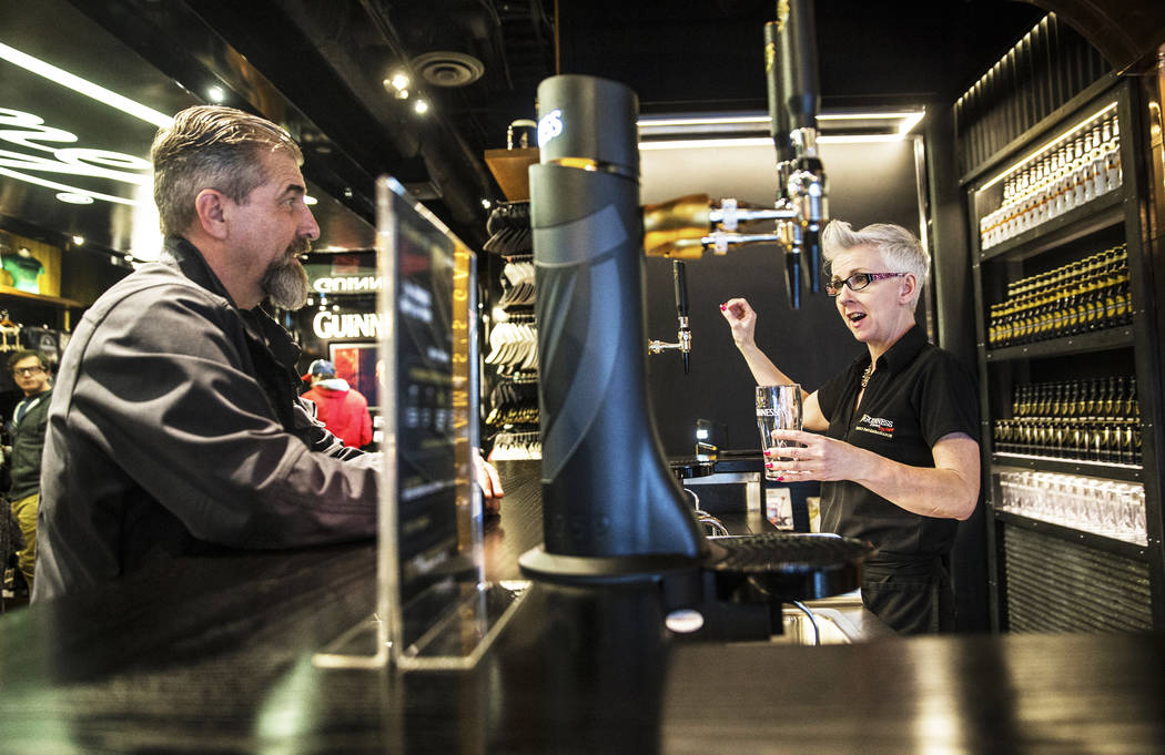 Honora Cosley, right, a perfect pint ambassador, walks John Notabartolo through The Guinness Experience on Thursday, March 2, 2017,at the Guinness Store in the Mandalay Bay hotel-casino, in Las Ve ...