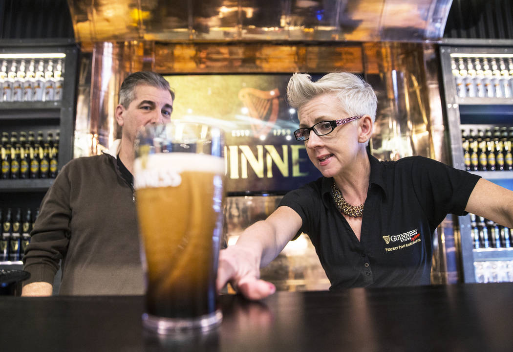 Honora Cosley, right, a perfect pint ambassador, points out  the proper way to pour a Guinness pint with John Notabartolo on Thursday, March 2, 2017, at The Guinness Experience at the Guinness Sto ...