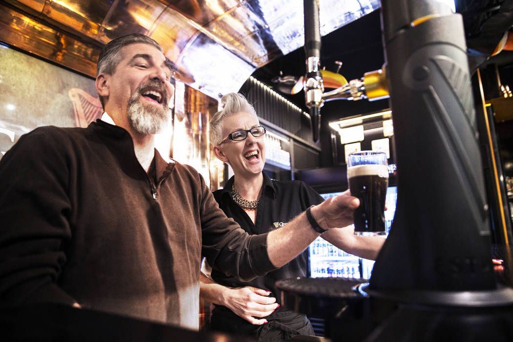 Honora Cosley, right, a perfect pint ambassador, helps John Notabartolo pour a pint of Guinness on Thursday, March 2, 2017, at The Guinness Experience at the Guinness Store in the Mandalay Bay hot ...