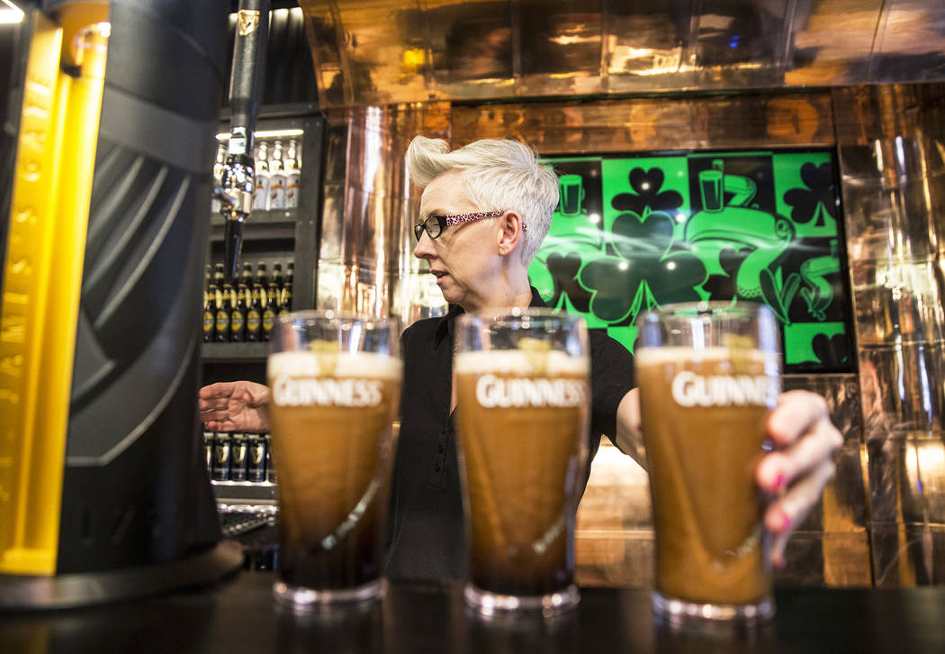 Honora Cosley, a perfect pint ambassador, pours four pints of Guinness on Thursday, March 2, 2017, at The Guinness Experience at the Guinness Store in the Mandalay Bay hotel-casino, in Las Vegas.  ...